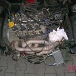Silnik 1.4 16V T-Jet. Rurowy kolektor wydechowy zbudowany pod turbo Garrett. Skrzynia biegów 6-bieg.