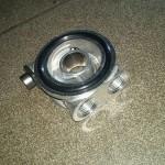 Podstawka filtra z termostatem oleju. Dla lepszego chłodzenia